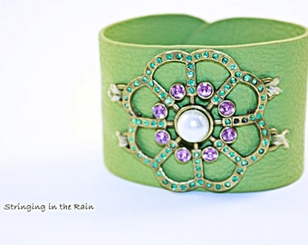 Leather cuff, green with large crystal and pearl accent piece and snap closure No. B