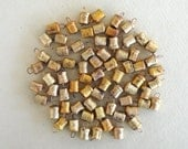 100 Golden Colored Hand Made Micro Cow Bells with Rough Look for Altered Art, Jewelry -with Jute Rope - DIY - MV119