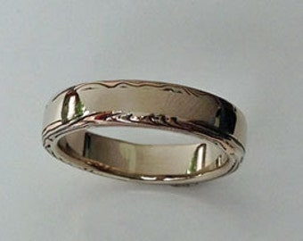 A hint of gold and silver mokume gane on 14k palladium white gold band