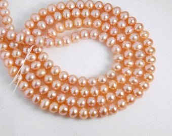 5-5.5mm off round freshwater pearls, one full 15-inch strand, grade AAA, natural pink color