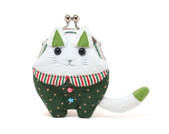 Socrates, the philosopher cat dressed in green