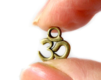Bronze Charms : 10 Antique Brass Ohm Charms / Bronze Yoga Ohm Pendants ... 9x11mm -- Lead, Nickel & Cadmium Free 4644.J5C