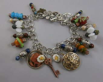 Lampwork Bead and Silver Secret Garden Themed Charm Bracelet