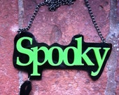 Green and Black Spooky laser cut acrylic necklace