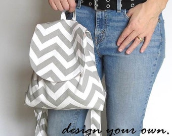 Backpack purse. Design your own in chevrons, paisley, tribals, linens. Fall trends in blue, taupes, grays.