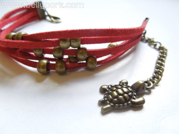Turtle bracelet. Red suede lace, with beads. Adjustable.