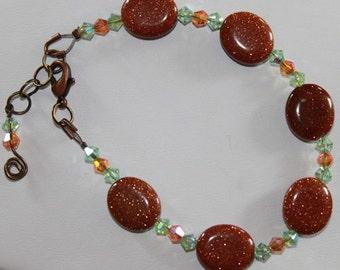 Goldstone, Amber and Peridot Swarovski Crystal Bracelet