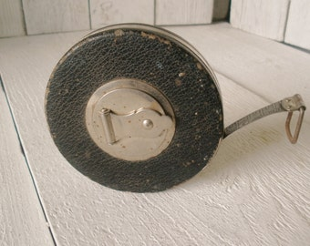 Vintage tape measure large round black vinyl metal tape Lufkin Rule 50 feet 1930s
