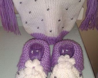 Hand made knitted baby hat and booties set