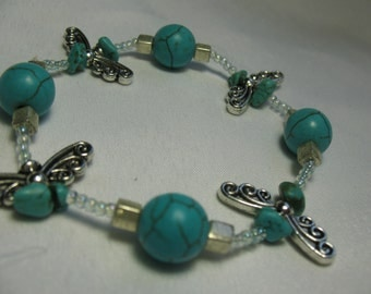 Spherical turquoise and fairy wings bracelet.