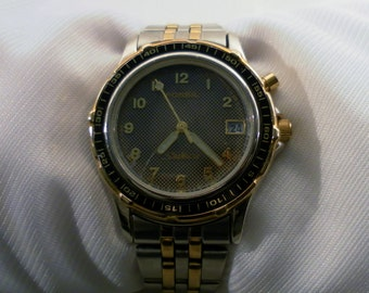 Vintage 1990s Fossil Starmaster Quartz Two Tone Ladies Watch. Org Stainless Steel Band.  Model LU-2538.  Works Fine.