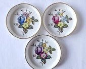 Three Royal Worcester coasters, hand painted floral decoration, 1960s