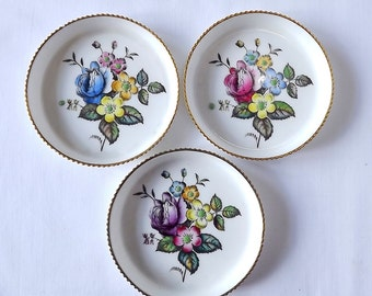 Three Royal Worcester coasters, or pin dishes with hand painted floral decoration, 1960s