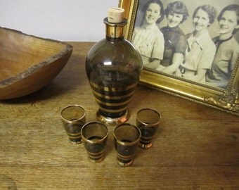 Vintage Smokey Brown and Gold Glass Decanter and four shot glasses.Roumanian made.