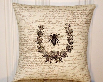 """shabby chic, feed sack, french country, vintage bee graphic on brown and creme script print 14"""" x 14"""" pillow sham."""