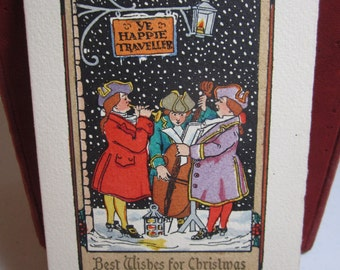 Unused gold gilded embossed hand colored 1920's-30's christmas card colonial renaissance dressed carolers musicians under sign for an inn
