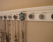 "jewelry organizer. This wall hung rack features large robins egg blue center knob and total of 9 decorative knobs 26 "" long. jewelry storage"