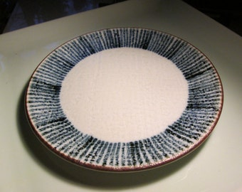 japanese hand made pre war 7 inch plate.. signed and dated 1935 texture, texture linen inside, cobalt and amber rim