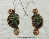 Wire wrapped copper cleff with green paper bead