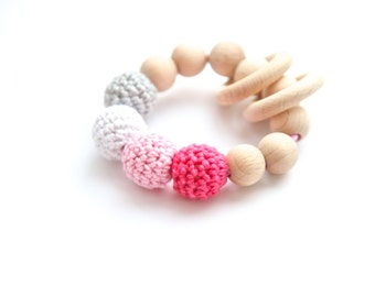 Shades of pink and grey ring toy with crochet wooden beads. Rattle for baby.