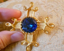 Vintage gold Maltese cross brooch with blue glass cabochon.  Art Deco.