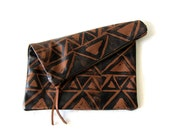 Large brown and black hand-printed leather triangles clutch