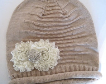 Tan Girls Slouch Beanie with Ivory Chiffon Flower and a Silver and Rhinestone Heart Accent.
