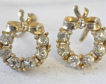 amazing pair of rhinestone wreath style with bow screw on earrings--vintage 1960s jewelry