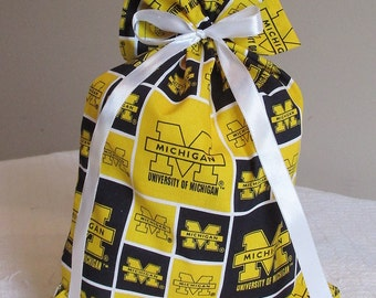 Small fabric gift bag in University of Michigan pattern.  Reusable.