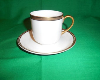 One (1), Demitasse Flat Cups & Saucers, from Johnson Bros., in the Raleigh (smooth-2 black rings) Pattern.