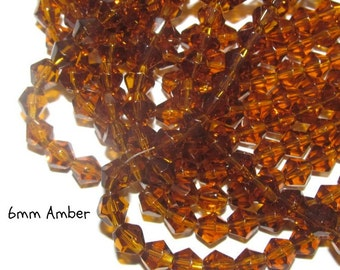 50 - 6mm Glass Bicones - amber (70)