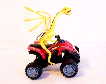 Baby Dragon George on an ATV: I'm yellow, but I'm not scared