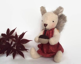 Squirrel holding an acorn. Can be personalised