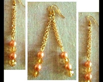 Long chain pearl and crystal earrings