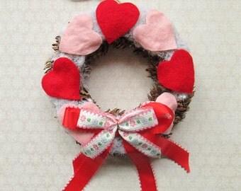 Snowy Pine Cone Heart Wreath