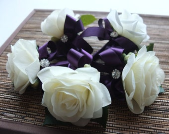 Elegant Off White Rose with Royal Purple ribbon and rhinestone accent