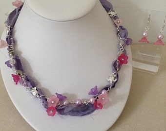 Pretty fresh water pearl, light amethyst and sari silk , necklace and earrings set with silver turtles and lucite flower detail