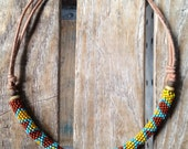 Authentic Peyote stitch necklace on high quality Greek leather cord with vintage bone and wood beads.