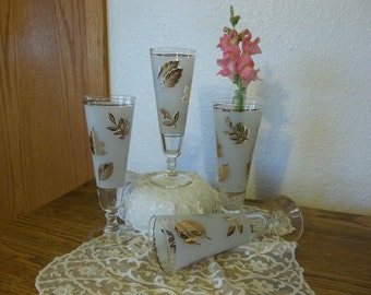 Elegant footed parfait glass  frosted with gold leaves of different species
