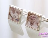 Silver plated pair of cuff links with vintage global map