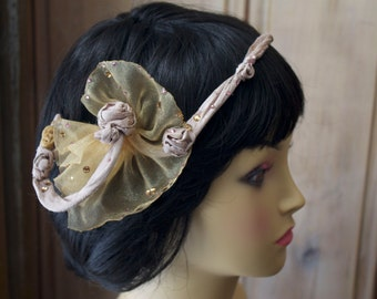 Pale rose head band with organza, Swarovski crystals and silk rosettes.