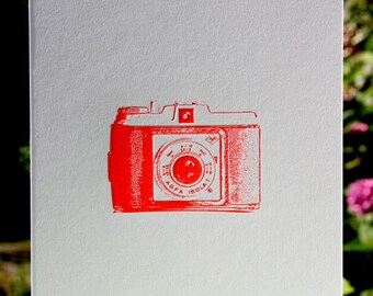 Letterpress poster vintage camera in neon red.