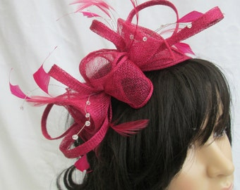 Stunning Raspberry pink Sinamay and  Feather rosette Fascinator