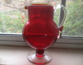 CRANBERRY RED GLASS pitcher with clear handle and base