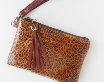Patent leather wristlet or clutch in leopard print.