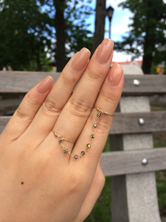 https://www.etsy.com/listing/190733055/mid-finger-chained-rings-with-smoky?ref=shop_home_feat_3
