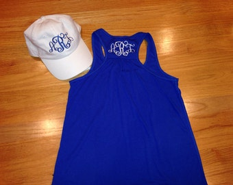 Blue flowy tank with initials and white hat with monogram