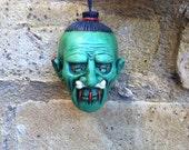 Green Shrunken Head Ceramic Dangler Dead Head Danglers tsantsa