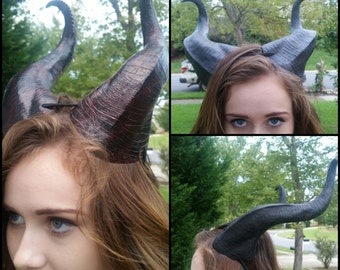 Cosplay character black brown red Bull sheep horns