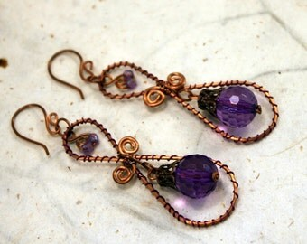 Copper wire wrapped earrings with purple faceted beads